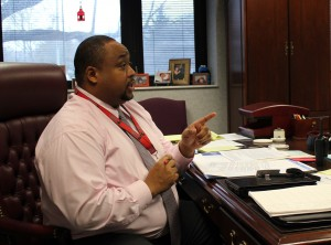 Evans Branigan III in his office at North Central. Branigan is JEA's Administrator of the Year.